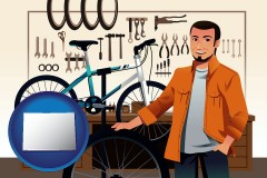 colorado map icon and bicycle shop mechanic
